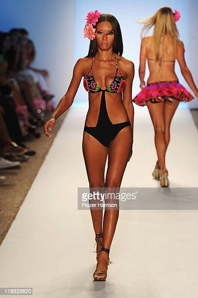 A model walks the runway at the Aguaclara show during MerecedesBenz Fashion Week Swim 2012 on July 18 2011 in Miami Beach United States