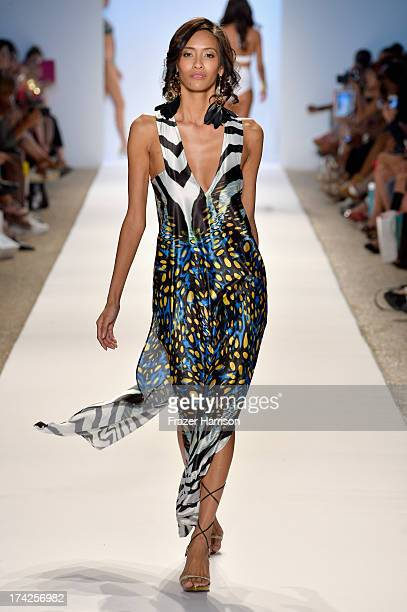 A model walks the runway at the Aguaclara Swimwear show at Cabana Grande at the Raleigh on July 22 2013 in Miami Florida