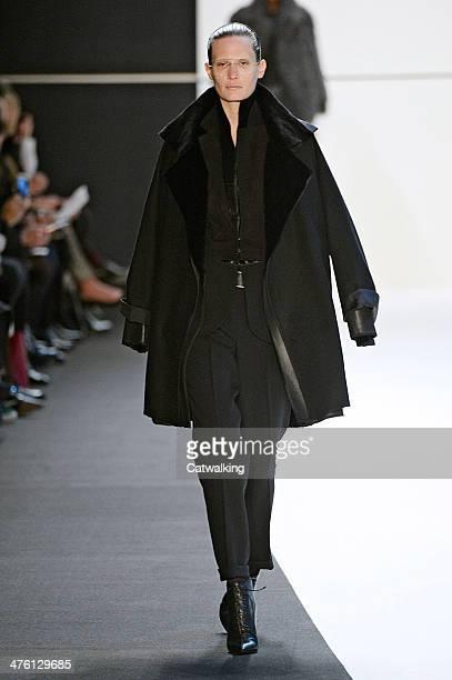A model walks the runway at the Akris Autumn Winter 2014 fashion show during Paris Fashion Week on March 2 2014 in Paris France