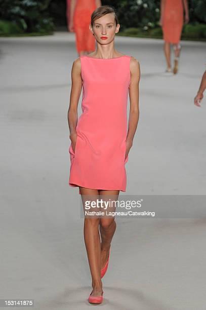 Model walks the runway at the Akris Spring Summer 2013 fashion show during Paris Fashion Week on September 30, 2012 in Paris, France.