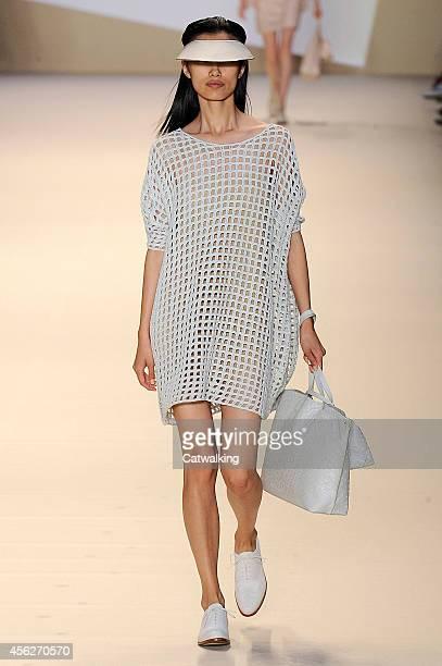 Model walks the runway at the Akris Spring Summer 2015 fashion show during Paris Fashion Week on September 28, 2014 in Paris, France.