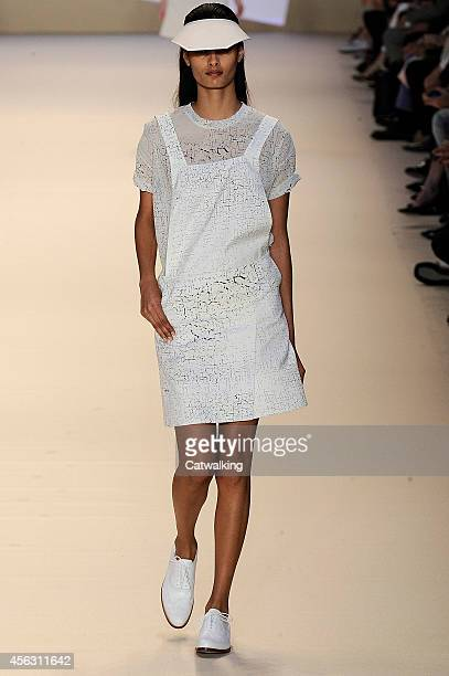 A model walks the runway at the Akris Spring Summer 2015 fashion show during Paris Fashion Week on September 28 2014 in Paris France