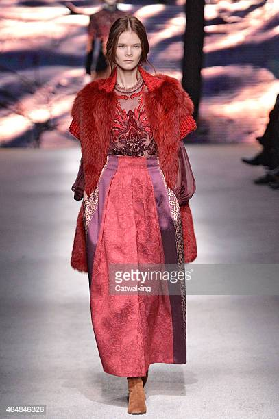 A model walks the runway at the Alberta Ferretti Autumn Winter 2015 fashion show during Milan Fashion Week on February 25 2015 in Milan Italy