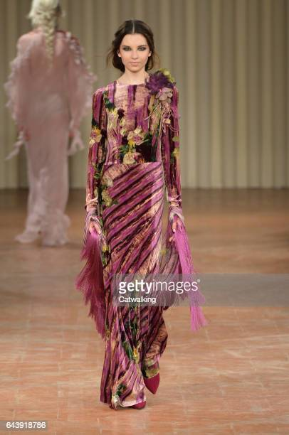 A model walks the runway at the Alberta Ferretti Autumn Winter 2017 fashion show during Milan Fashion Week on February 22 2017 in Milan Italy