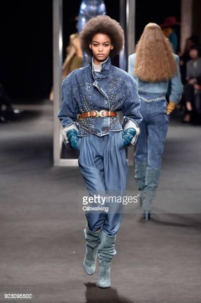 A model walks the runway at the Alberta Ferretti Autumn Winter 2018 fashion show during Milan Fashion Week on February 21 2018 in Milan Italy