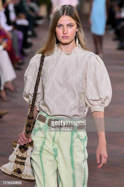 Model walks the runway at the Alberta Ferretti Ready to Wear Spring/Summer 2021 fashion show during the Milan Women's Fashion Week on September 23,...