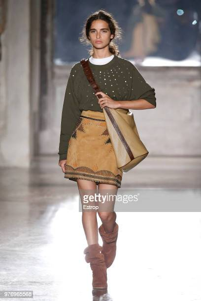A model walks the runway at the Alberta Ferretti show during Milan Men's Fashion Week Spring/Summer 2019 on June 15 2018 in Milan Italy