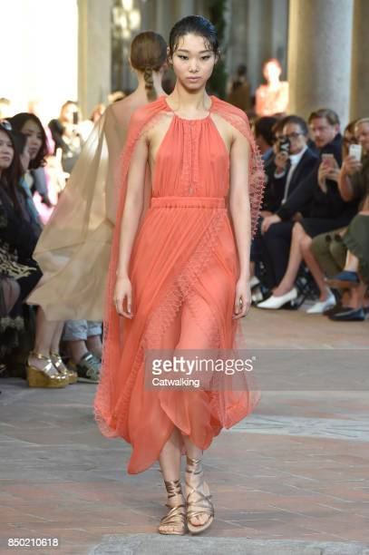 A model walks the runway at the Alberta Ferretti Spring Summer 2018 fashion show during Milan Fashion Week on September 20 2017 in Milan Italy