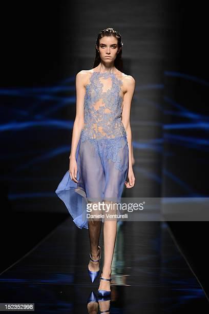 Model walks the runway at the Alberta Ferretti Spring/Summer 2013 fashion show as part of Milan Womenswear Fashion Week on September 19, 2012 in...
