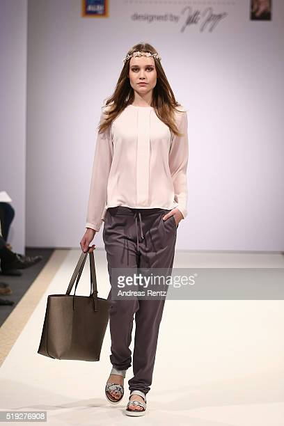 A model walks the runway at the ALDI SUED Blue Motion by Jette Joop fashion show on April 5 2016 in Duesseldorf Germany