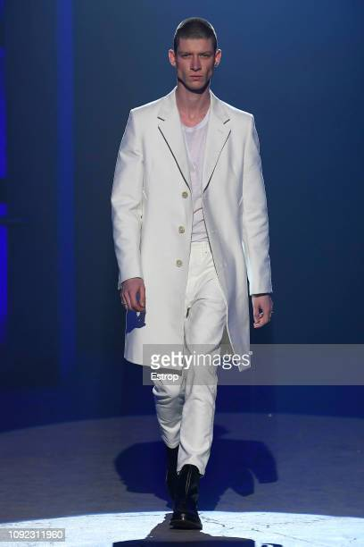 A model walks the runway at the AldoMariaCamillo show during the 95th Pitti Uomo on January 10 2019 in Florence Italy