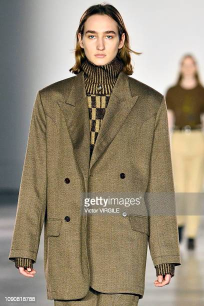A model walks the runway at the Alex Mullins Fall/Winter 20192020 fashion show during London Fashion Week Men's January 2019 at the BFC Show Space on...