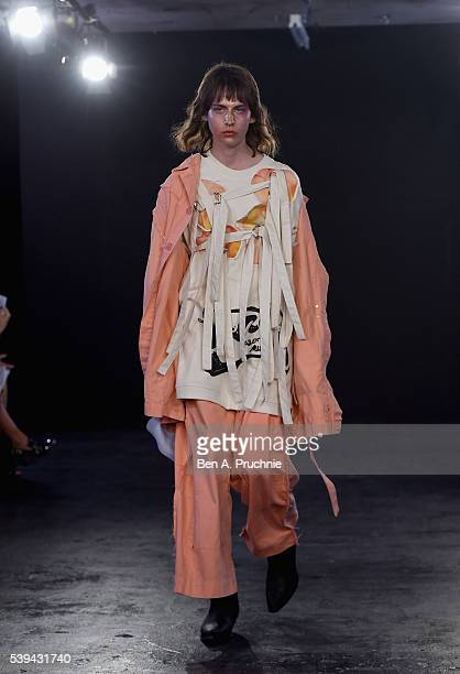 A model walks the runway at the Alex Mullins Salon show during The London Collections Men SS17 at BFC Presentation Space on June 11 2016 in London...