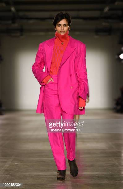 A model walks the runway at the Alex Mullins show during London Fashion Week Men's January 2019 at the BFC Show Space on January 06 2019 in London...
