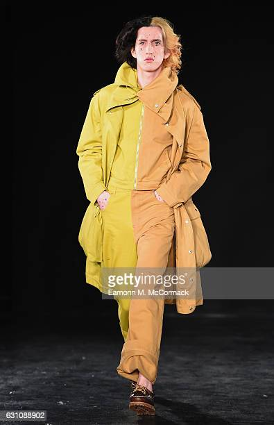 Model walks the runway at the Alex Mullins show during London Fashion Week Men's January 2017 collections at BFC Presentation Space on January 6,...