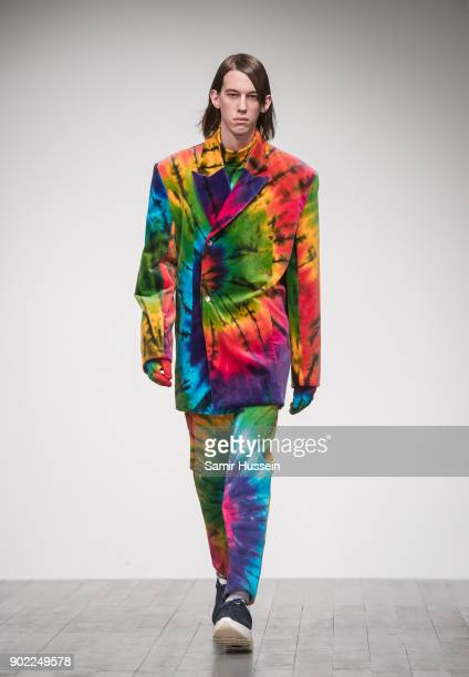 A model walks the runway at the Alex Mullins show during London Fashion Week Men's January 2018 at BFC Show Space on January 7 2018 in London England