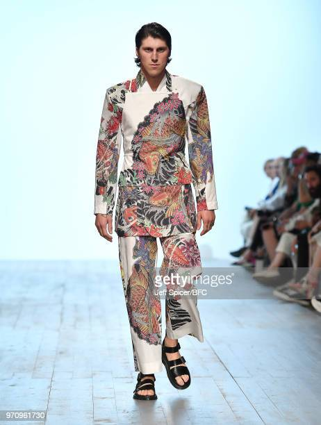 A model walks the runway at the Alex Mullins show during London Fashion Week Men's June 2018 at the BFC Show Space on June 10 2018 in London England