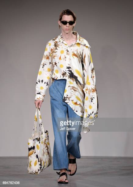 A model walks the runway at the Alex Mullins show during the London Fashion Week Men's June 2017 collections on June 11 2017 in London England
