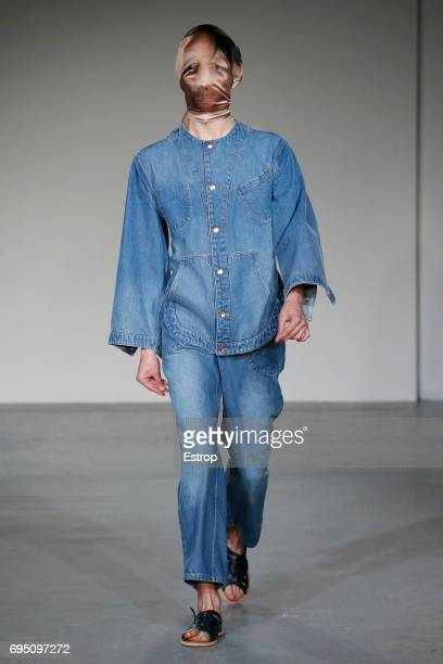 A model walks the runway at the Alex Mullins show during the London Fashion Week Men's June 2017 collections on June 10 2017 in London England