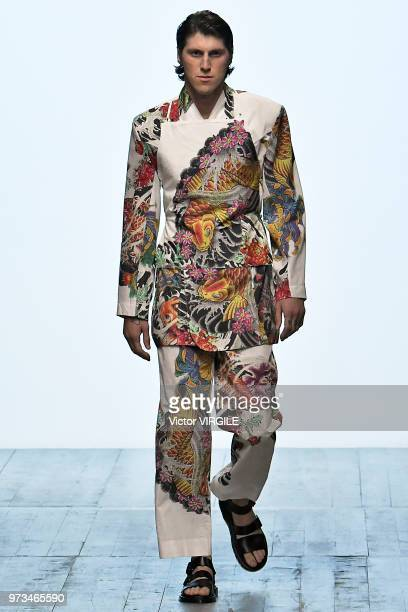 A model walks the runway at the Alex Mullins Spring/Summer 2019 fashion show during London Fashion Week Men's June 2018 on June 10 2018 in London...