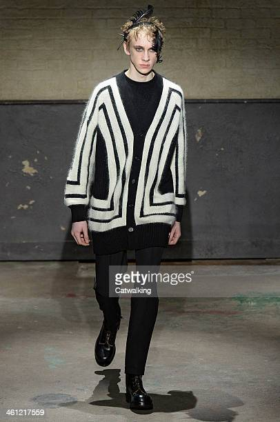A model walks the runway at the Alexander McQueen Autumn Winter 2014 fashion show during London Menswear Fashion Week on January 7 2014 in London...