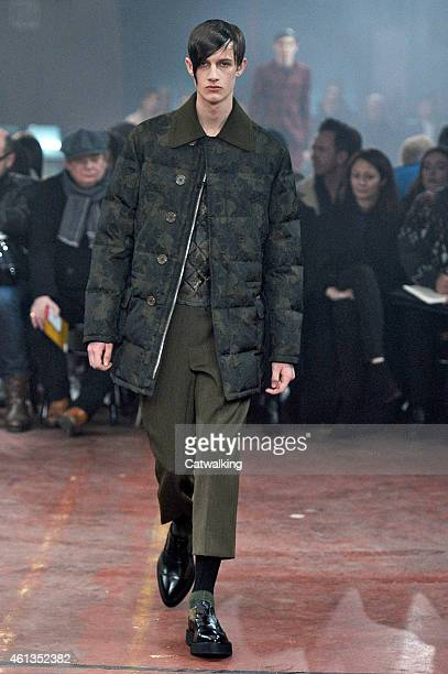 A model walks the runway at the Alexander McQueen Autumn Winter 2015 fashion show during London Menswear Fashion Week on January 11 2015 in London...