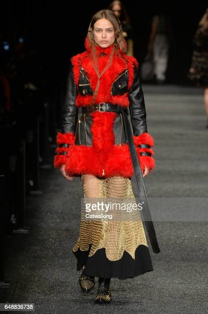 A model walks the runway at the Alexander McQueen Autumn Winter 2017 fashion show during Paris Fashion Week on March 6 2017 in Paris France