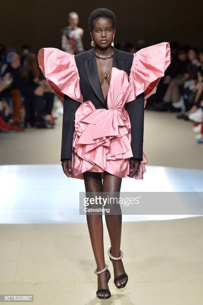 A model walks the runway at the Alexander McQueen Autumn Winter 2018 fashion show during Paris Fashion Week on March 5 2018 in Paris France