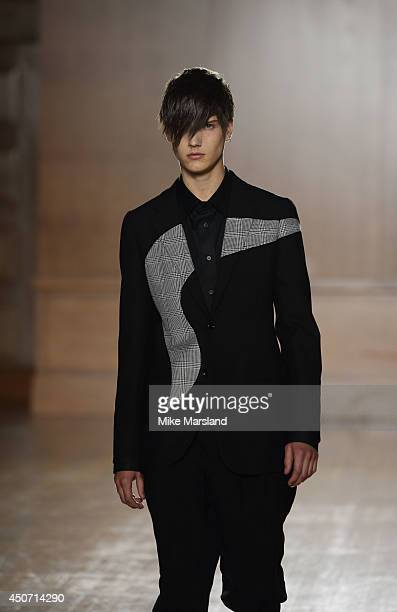 A model walks the runway at the Alexander McQueen show during the London Collections Men SS15 on June 16 2014 in London England