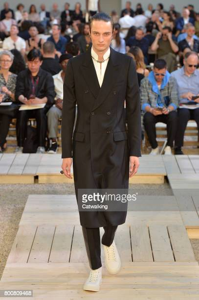 A model walks the runway at the Alexander McQueen Spring Summer 2018 fashion show during Paris Menswear Fashion Week on June 25 2017 in Paris France