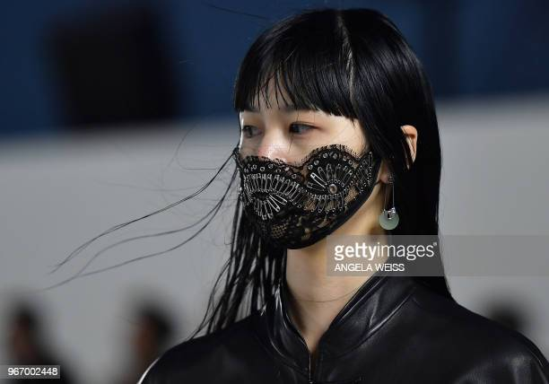 TOPSHOT A model walks the runway at the Alexander Wang Collection 1 show at Pier 17 on June 3 2018 in New York City