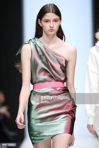 A model walks the runway at the ALEXANDR ROGOV fashion show during day five of Mercedes Benz Fashion Week Russia S/S 2018 at Manege on October 25...