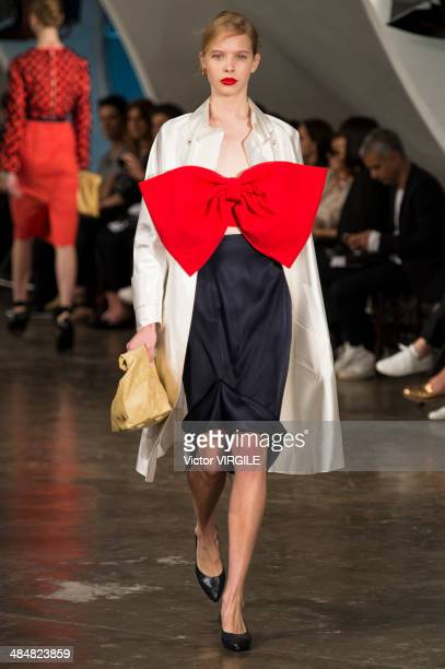 Model walks the runway at the Alexandre Herchcovitch show during Sao Paulo Fashion Week Summer 2014/2015 at Parque Candido Portinari on April 1, 2014...