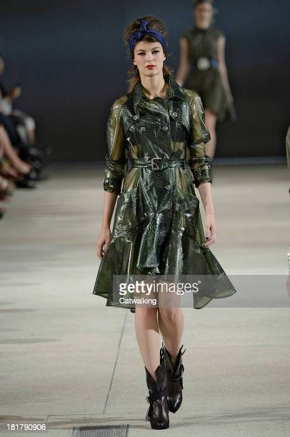 Model walks the runway at the Alexis Mabille Spring Summer 2014 fashion show during Paris Fashion Week on September 25, 2013 in Paris, France.