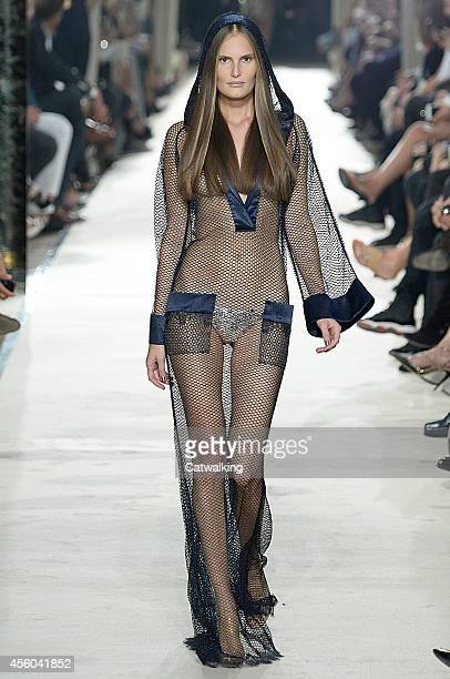 A model walks the runway at the Alexis Mabille Spring Summer 2015 fashion show during Paris Fashion Week on September 24 2014 in Paris France
