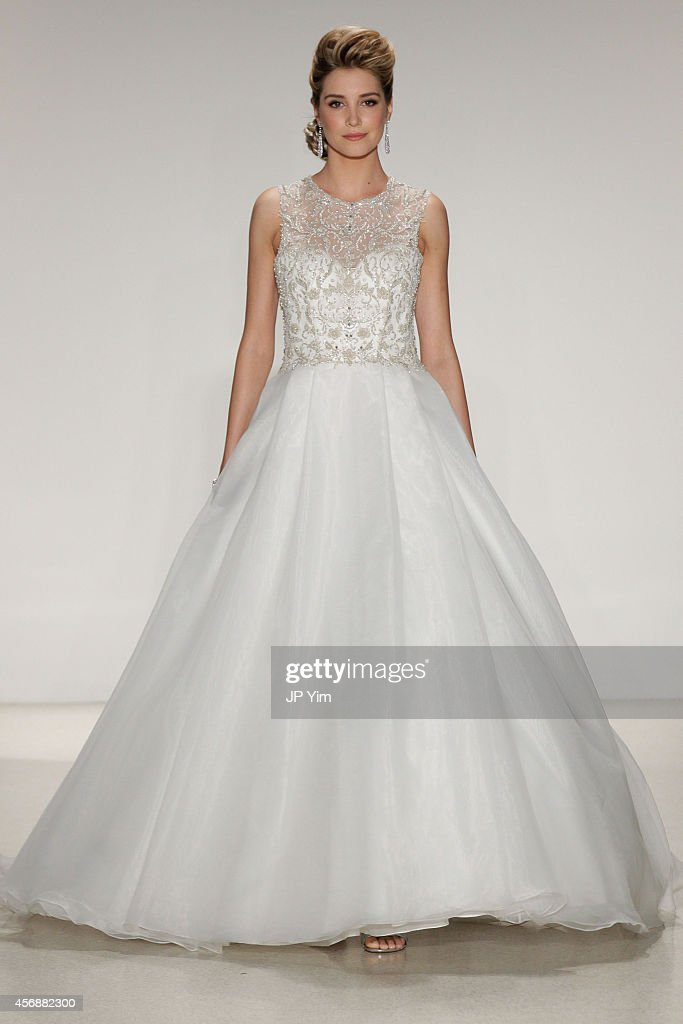 A model walks the runway at the Alfred Angelo Spring 2015 Bridal Collection at EZ Studios on October 8, 2014 in New York City.