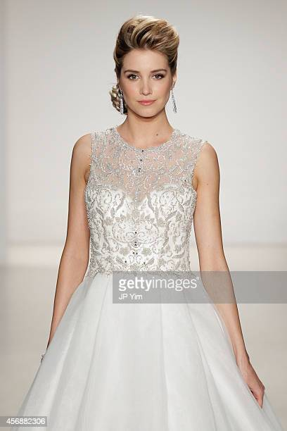 A model walks the runway at the Alfred Angelo Spring 2015 Bridal Collection at EZ Studios on October 8 2014 in New York City