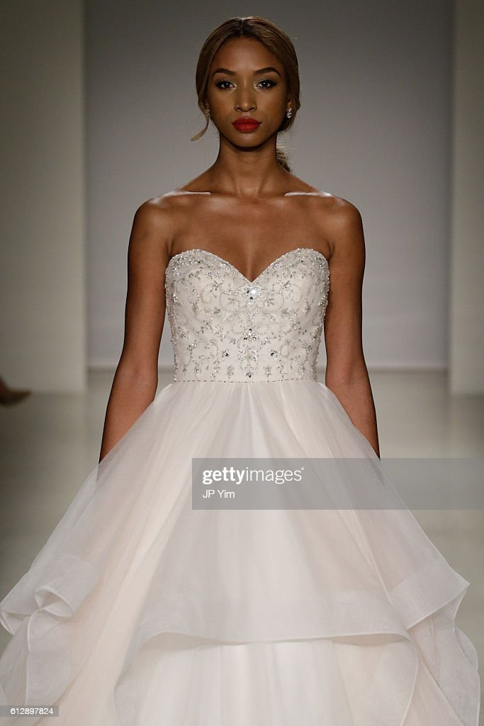 A model walks the runway at the Alfred Angelo Spring 2017 Bridal Show with Disney Weddings at EZ Studios on October 5, 2016 in New York City.