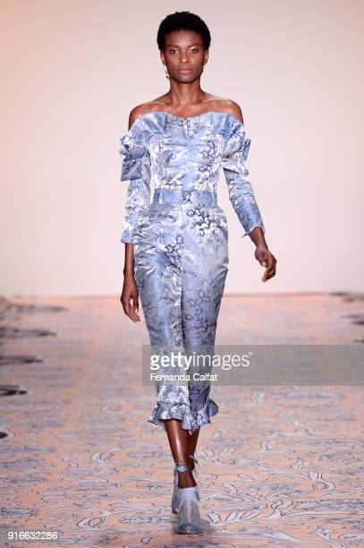 A model walks the runway at the alice McCALL fashion show during New York Week The Shows at Industria Studios on February 10 2018 in New York City