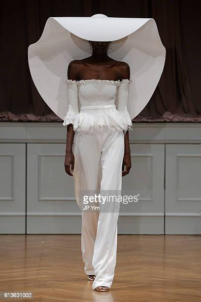 A model walks the runway at the Alon Livne White 2017 Bridal Collection at the Bohemian Benevolent and Literary Association on October 9 2016 in New...