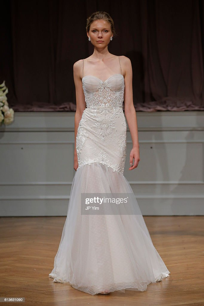 A model walks the runway at the Alon Livne White 2017 Bridal Collection at the Bohemian Benevolent and Literary Association on October 9, 2016 in New York City.