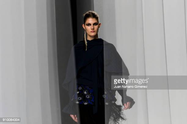 A model walks the runway at the Alvarno show during the MercedesBenz Fashion Week Madrid Autumn/Winter 201819 at Ifema on January 25 2018 in Madrid...