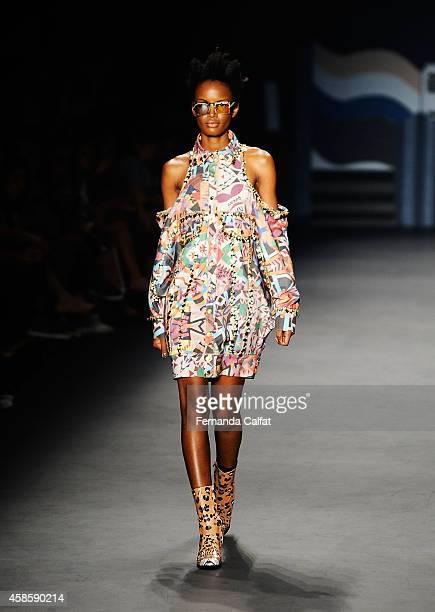 A model walks the runway at the Amapo fashion show during Sao Paulo Fashion Week Winter 2015 at Parque Candido Portinari on November 7 2014 in Sao...