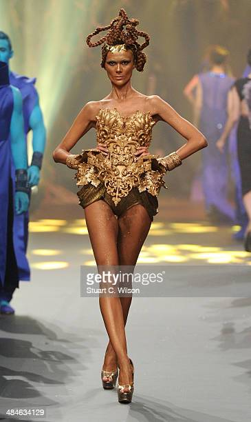 A model walks the runway at the Amato By Furne One show during Fashion Forward at Madinat Jumeirah on April 13 2014 in Dubai United Arab Emirates