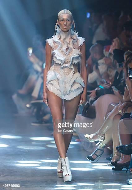 A model walks the runway at the Amato show during Fashion Forward at Madinat Jumeirah on October 6 2014 in Dubai United Arab Emirates