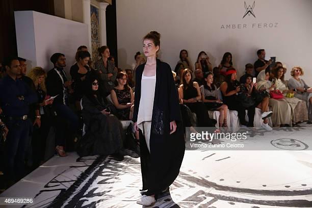 A model walks the runway at the Amber Feroz presentation during Dubai Fashion Forward April 2015 at Madinat Jumeirah on April 12 2015 in Dubai United...