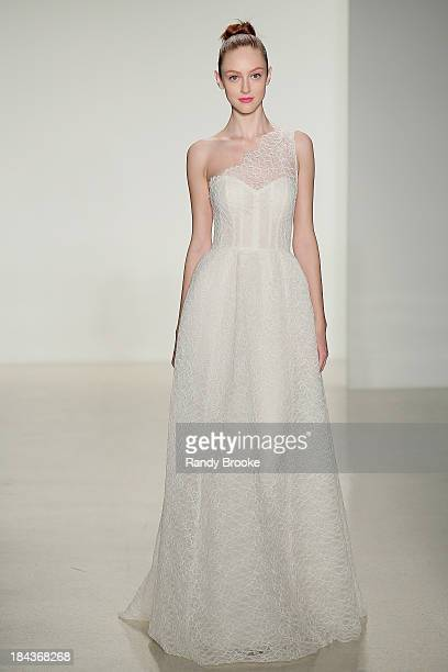 Model walks the runway at the Amsale Fall 2014 Bridal collection show at EZ Studios on October 12, 2013 in New York City.