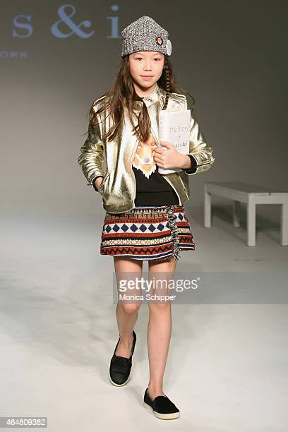 A model walks the runway at the Anais I show during petitePARADE / Kids Fashion Week at Bathhouse Studios on February 28 2015 in New York City