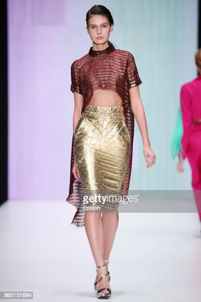 A model walks the runway at the Anastasia Dokuchaeva fashion show during day two of Mercedes Benz Fashion Week Russia S/S 2018 at Manege on October...