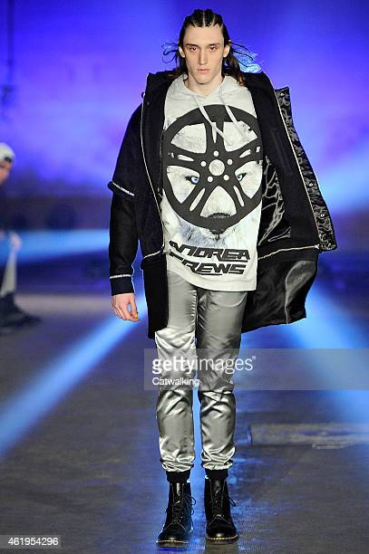 A model walks the runway at the Andrea Crews Autumn Winter 2015 fashion show during Paris Menswear Fashion Week on January 22 2015 in Paris France